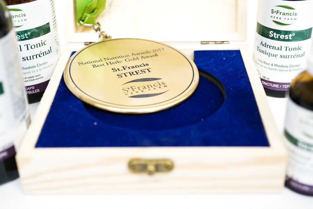 A National Nutrition gold award in a blue box surrounded by the Strest product line