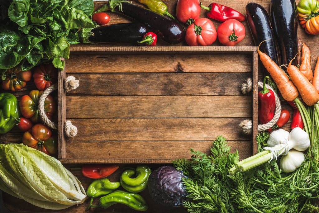 Picture of Wood board surrounded by vegetables