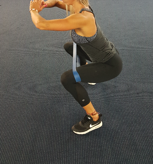 mini band squat, squat with resistance band, mini loop bands