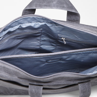 Messenger bag made from organic waxed canvas. Charcoal gray, multiple organization, gray topo recycled polyester liner - aTana Day Tripper