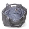 Large tote made from gray organic waxed canvas. Gray topo custom interior liner made from recycled polyester. Magnet closure.