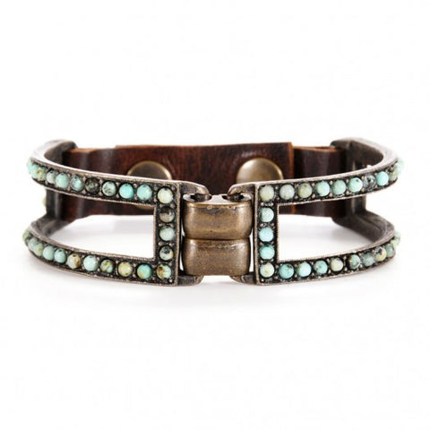 Be sure to look rustic chic in this unique 2 bar metal bracelet with semi-precious stones in African turquoise. Metal trim detail at center front, adjustable snap closure, antique brass finish.