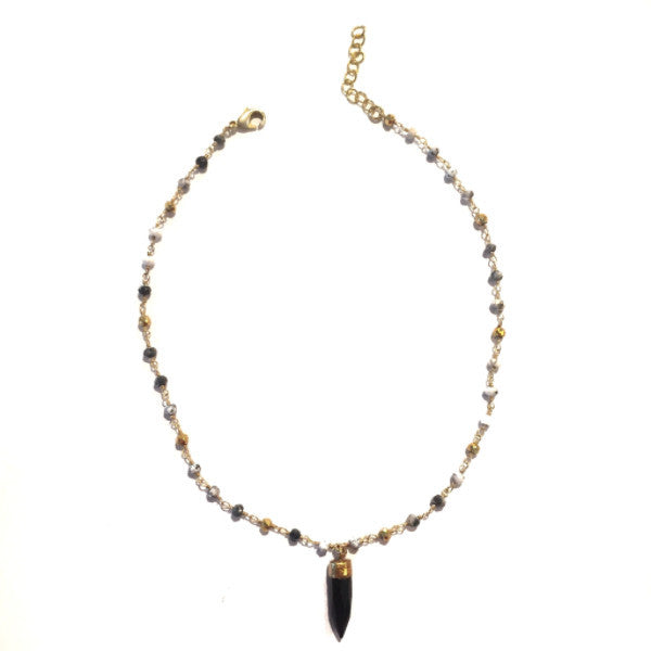 Delicate gold choker necklace with mini bullet pendant in blue. From Nikko Blu. 2