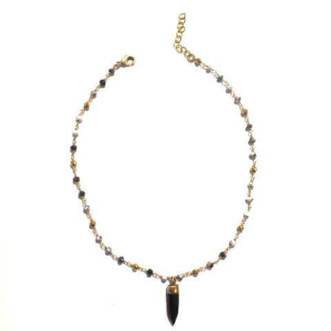 "Weather you layer this pretty girl or wear solo you're sure to stand out and look gorg. Delicate choker necklace with small beads and bullet stone pendant. Available in blue multi color. 2"" extender"