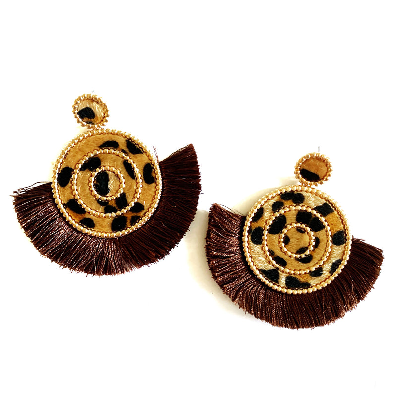 Round earring with brown tassel and leopard print base. The earring features a post back closure and measures 2.5