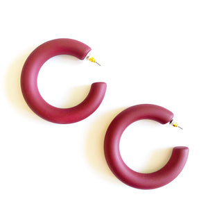 "colorful hoop that is light-weight and ready to take you from day to night. Measures 2"". Thick burgundy hoop"
