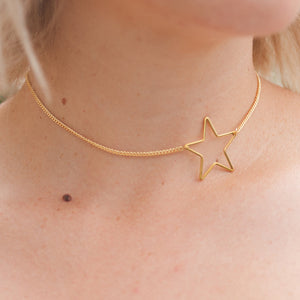"Choker with off-centered star shaped pendant measures 12"". 14kt gold-plated over brass. Lucky Star Jewelry, dainty gold choker"