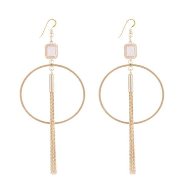 Gold hoop earring attached with either light mint stone with tassel