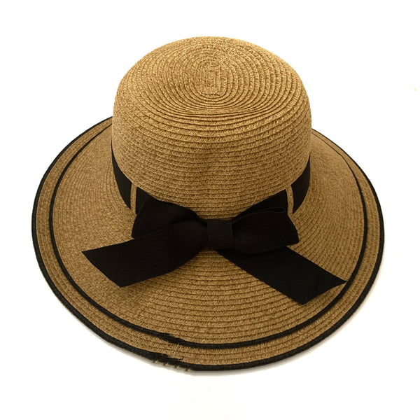 under $50 hat, hat with bow, tan hat, hat is UPF 50+. Only 1/50 of the sun's UV radiation can penetrate this fabric. Blocks UVA and UVB.   Hat has a bow in the back and has fabric in the body to fit all sizes.   88% paper and 12% polyester.