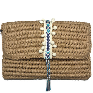 white straw clutch with pom white pom. magnetic closure. spring trend, day clutch with pom pom. From Fallon and Royce
