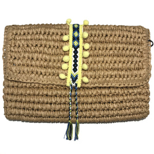yellow straw clutch with yellow pom pom. magnetic closure. day clutch. fallon and royce