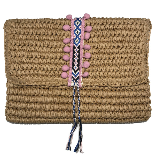 pink straw clutch with pink pom pom. magnetic closure. spring trend, day clutch, pom-poms. From Fallon and Royce