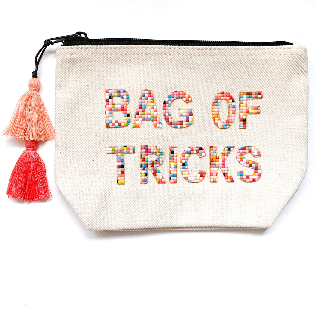 cheeky canvas makeup bag with colorful lettering from fallon and royce