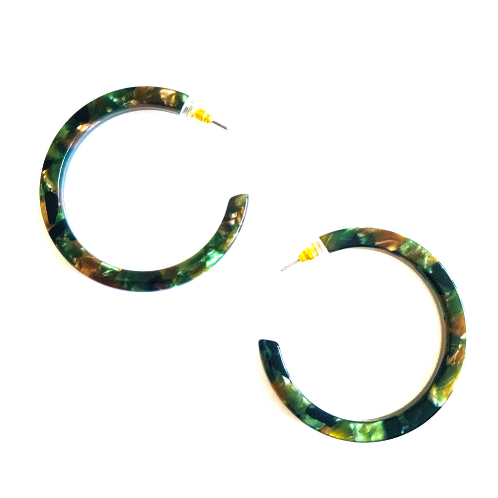 "Acrylic earring with hoop silhouette in green and brown multi. Post back closure. Measures 1.5"" trendy earrings, medium sized hoop earring, green earring"