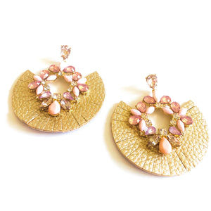 "Circular earring with gold trim and embellished synthetic crystals. Measures 2.5"" Fabric earring, pink embellished earring"