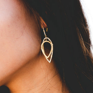 Gold or rose gold pave double pointed teardrop earring with lever back.