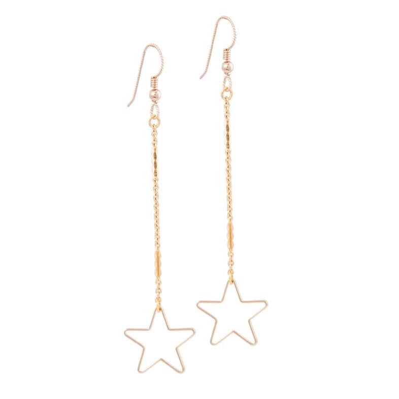 Dainty dangled star earrings make for the perfect ear accessory.