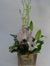 Oriental Lilies and Orchids - hessian flowers arrangement