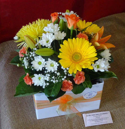 Bright and colourful floral arrangements with white, yellow and orange shades