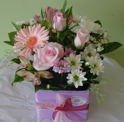 Flower arrangement of flowers with roses, gerberas, alstromeria and chrysanthemums