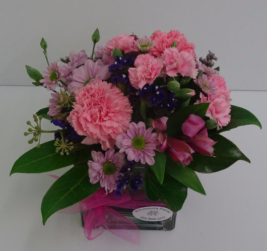 Pink floral design with carnations, spray carnations alstromeria and chrysanthumum