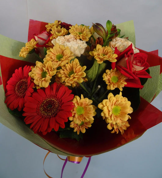 Hand made florist arrangement with Roses, Gerberas, Chrysanthemums and Sim Carnations