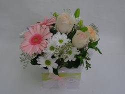 Light shades of white and pink in this flower arrangement