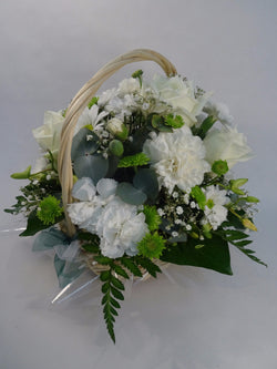 Flowers, green and white in a basket