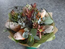 Native arrangement with banksia, eucalyptus and silvan red flowers