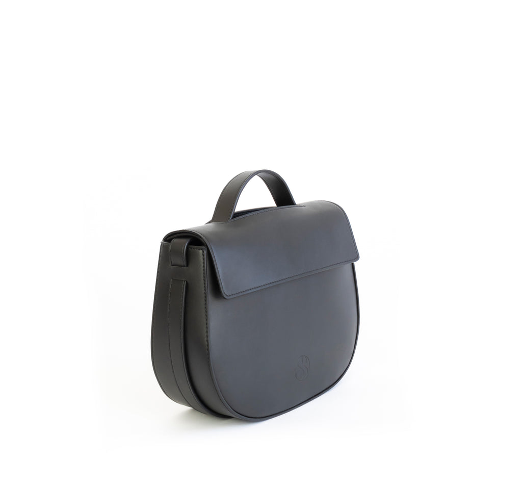Eco vegan leather crossbody bag by Sydney Brown. Timeless, classic and modern. Angle view