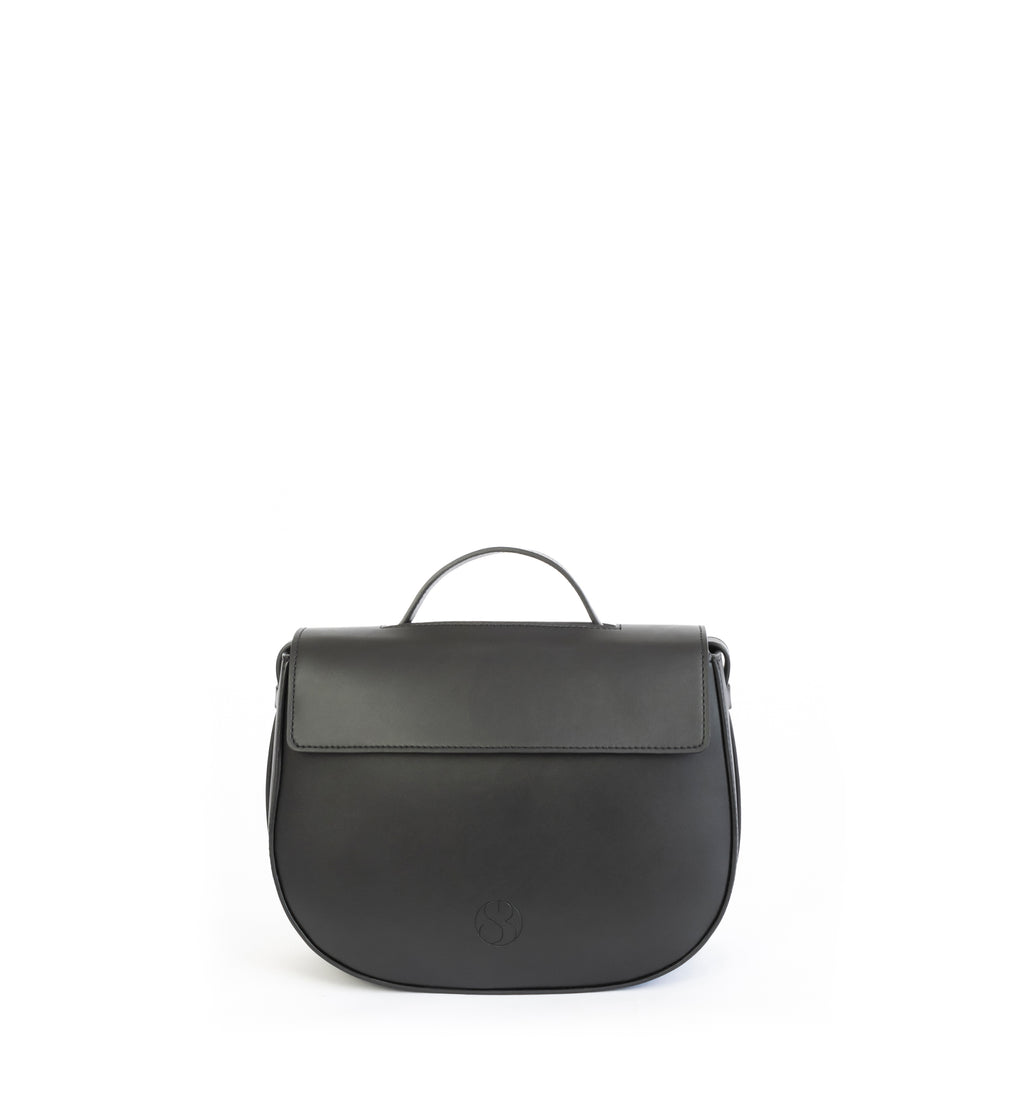 Eco vegan leather crossbody bag by Sydney Brown. Timeless, classic and modern. Front view