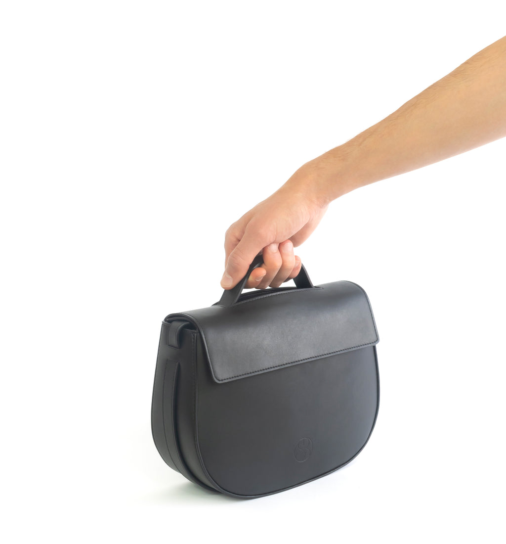 Eco vegan leather crossbody bag by Sydney Brown. Timeless, classic and modern.  Hand view