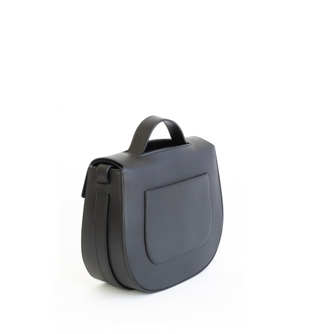 Eco vegan leather crossbody bag by Sydney Brown. Timeless, classic and modern. Back Angle view