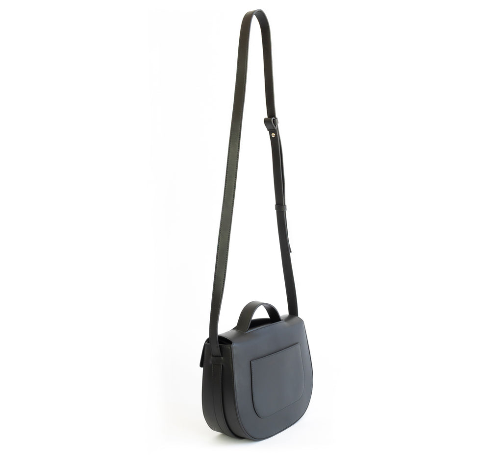 Eco vegan leather crossbody bag by Sydney Brown. Timeless, classic and modern. Shoulder or crossbody strap view.