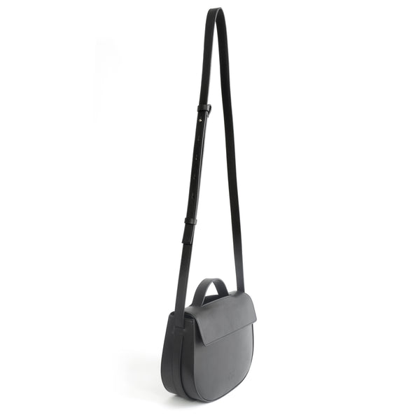 Eco vegan leather crossbody bag by Sydney Brown. Timeless, classic and modern. Shoulder or crossbody strap angle view.