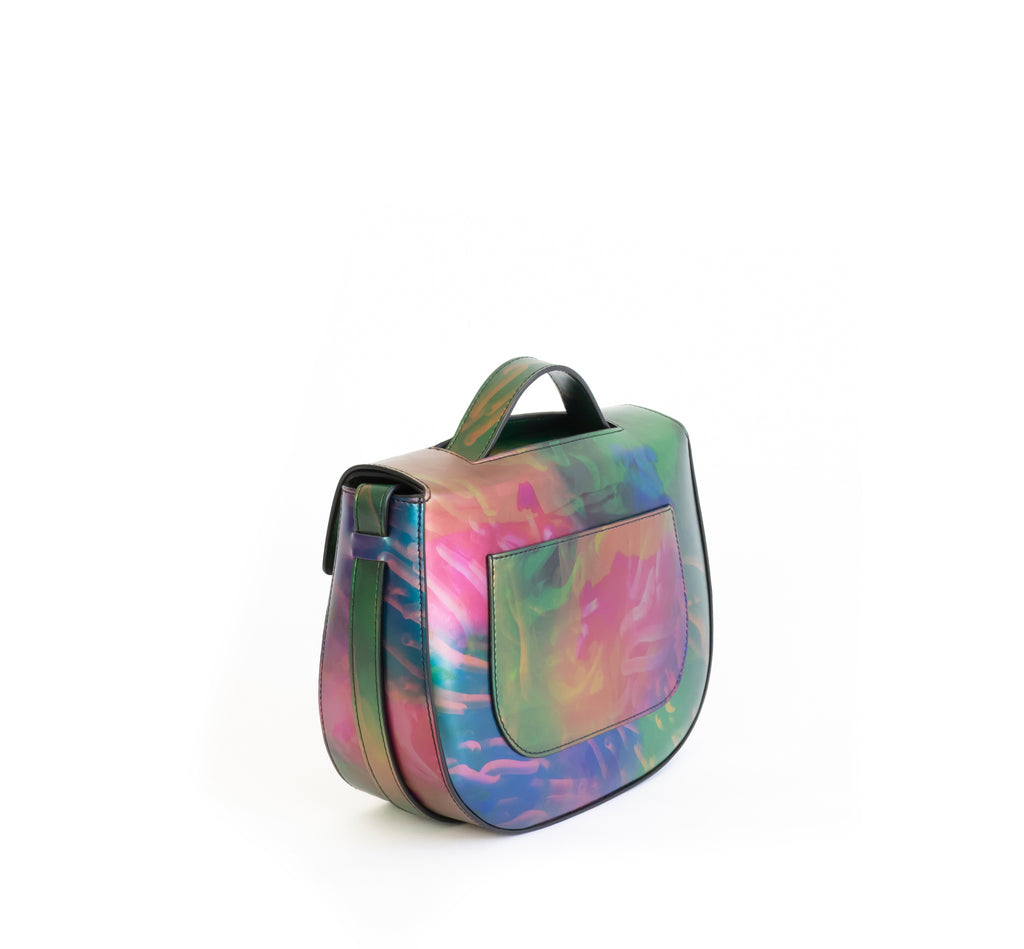 Printed iridescent vegan leather crossbody bag by Sydney Brown. Timeless, classic and modern.  Angle Back view.
