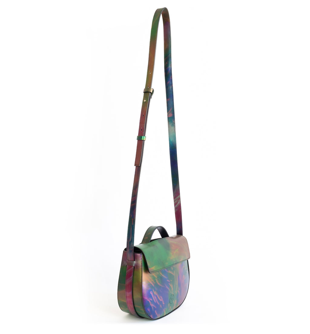 Printed iridescent vegan leather crossbody bag by Sydney Brown. Timeless, classic and modern.  Angle front crossbody, shoulder strap.