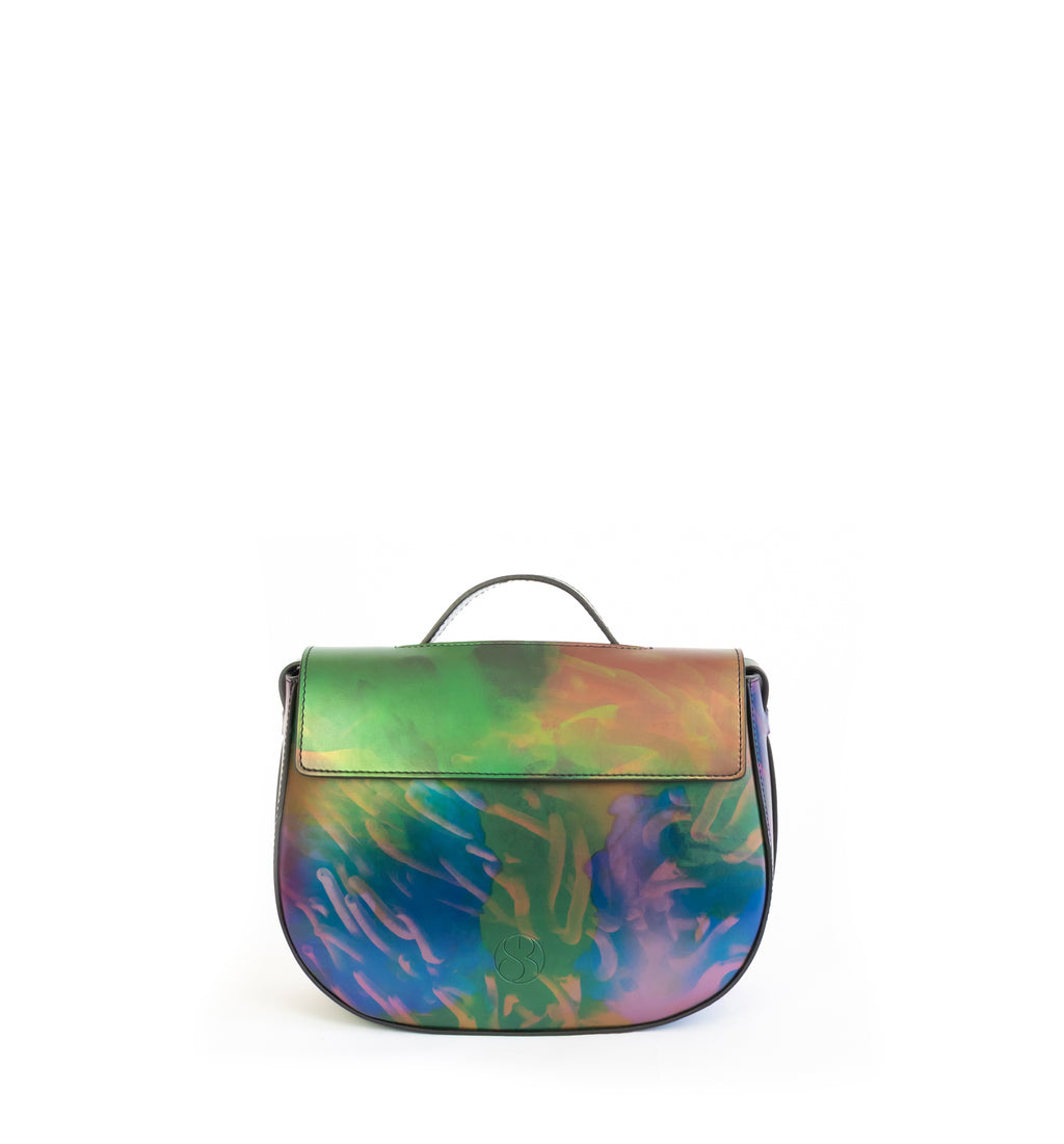 Printed iridescent vegan leather crossbody bag by Sydney Brown. Timeless, classic and modern. Front view.