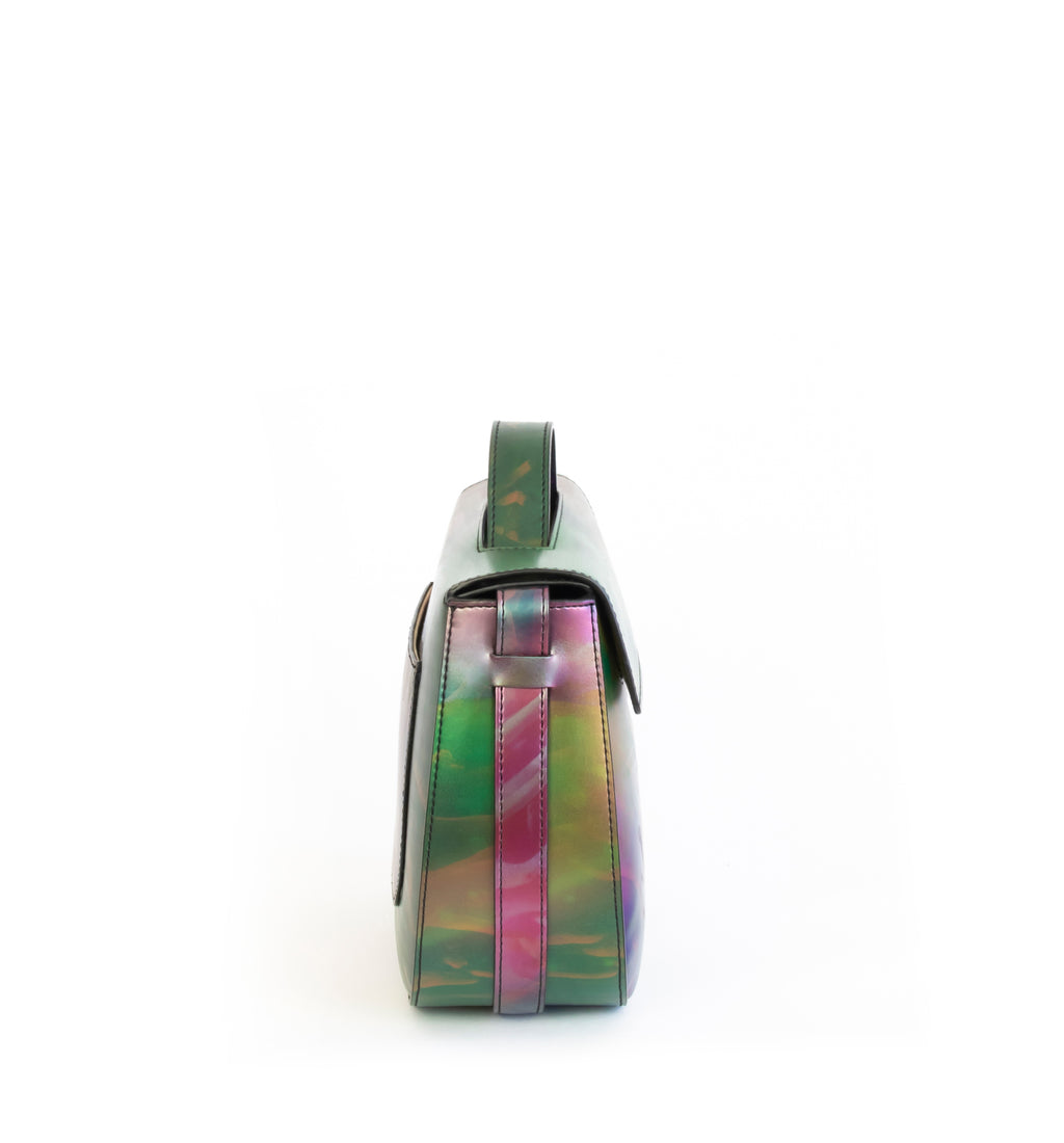 Printed iridescent vegan leather crossbody bag by Sydney Brown. Timeless, classic and modern.  Side view.