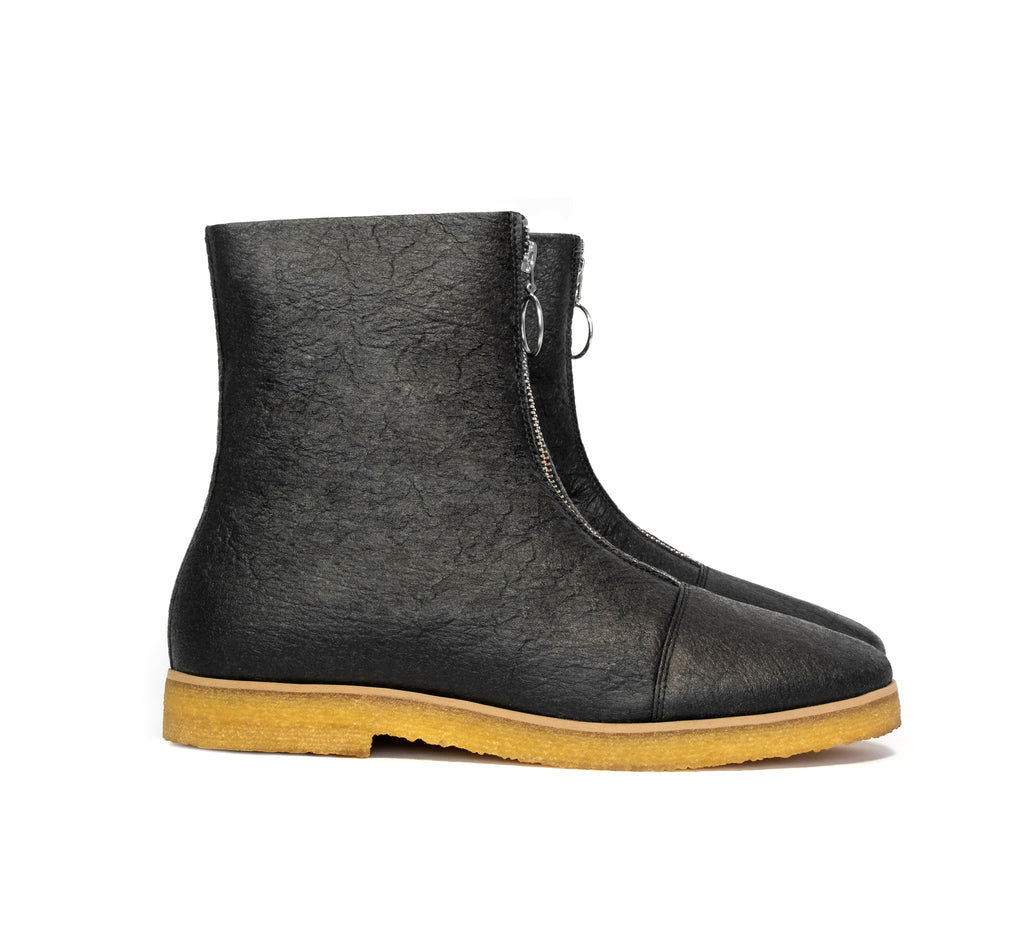 Boot in Black vegan pineapple leather alternative, pinatex, frontal zip, almond toe, natural rubber crepe sole.
