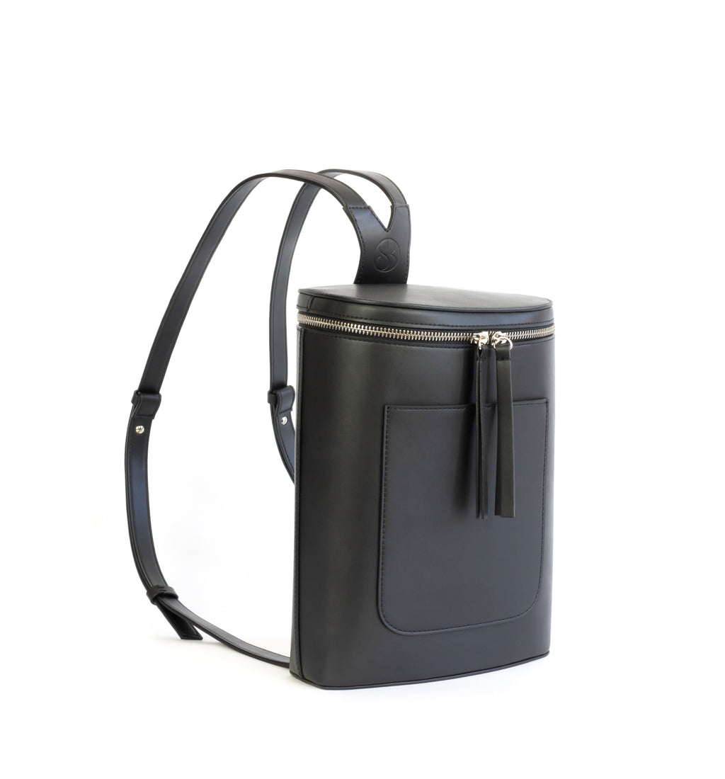Black eco vegan leather bucket backpack by Sydney Brown. Timeless, classic and modern. Angle