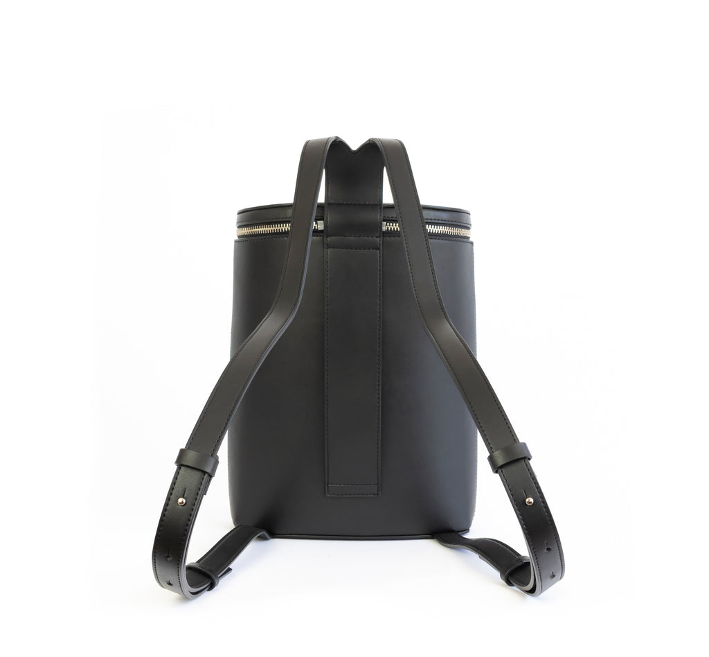 Black eco vegan leather bucket backpack by Sydney Brown. Timeless, classic and modern.  Back view