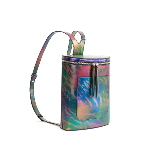 Printed iridescent vegan leather bucket backpack by Sydney Brown. Timeless, classic and modern.  Angle