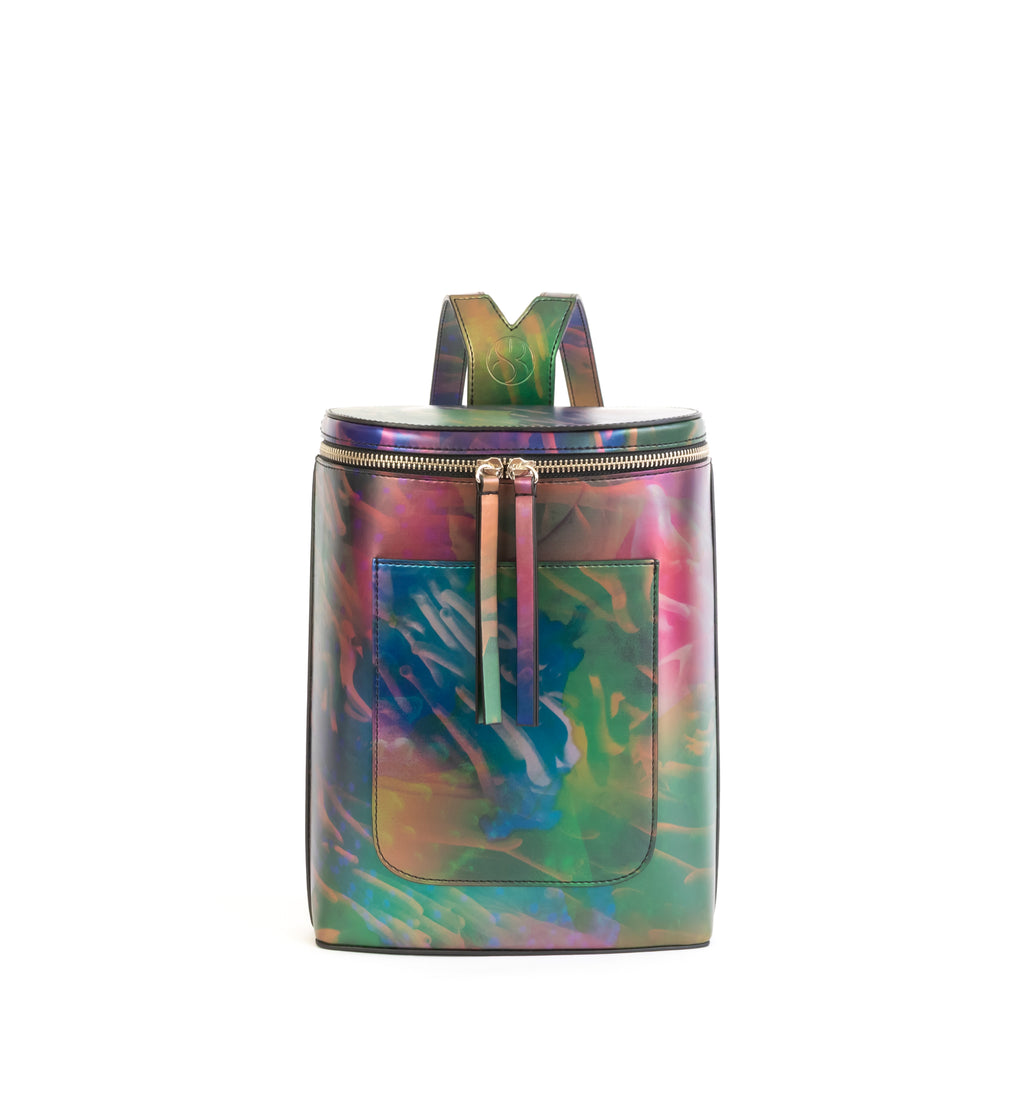 Printed iridescent vegan leather bucket backpack by Sydney Brown. Timeless, classic and modern. Front view.
