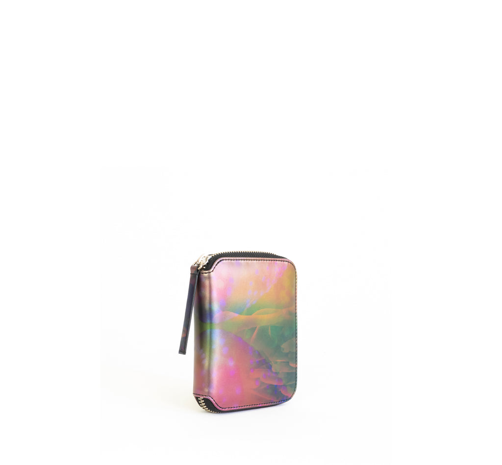Unisex zipped wallet with inside coin pouch and card slots. Iridescent Print faux-leather. Front Angle