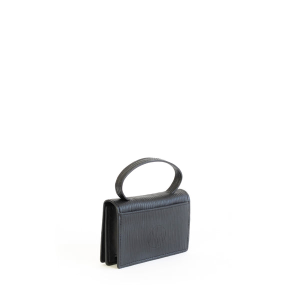 Microbag wallet with handle and an interior and exterior card slot. Black emboss faux-leather. Angle