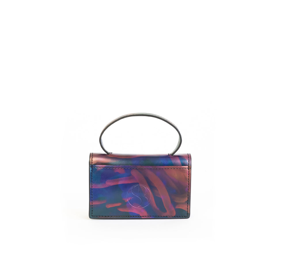 Microbag wallet with handle and an interior and exterior card slot. Iridescent Print faux-leather. Back