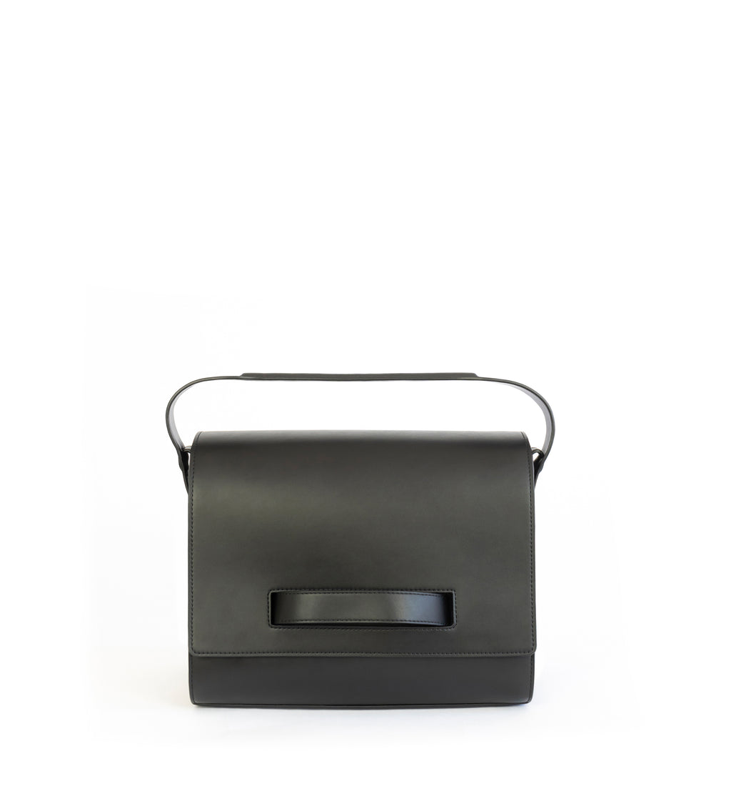 Black eco vegan leather barrel shoulder bag by Sydney Brown. Timeless, classic and modern. Front view