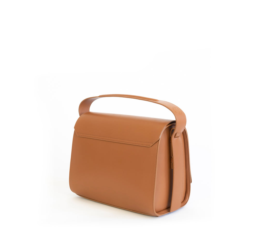 Brown eco vegan leather barrel shoulder bag by Sydney Brown. Timeless, classic and modern. Angle Back view