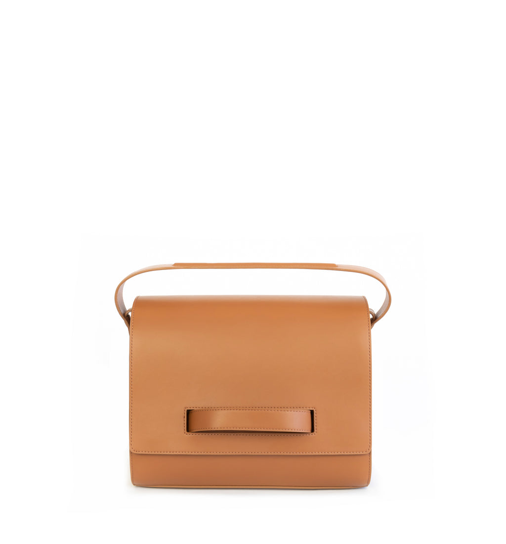 Brown eco vegan leather barrel shoulder bag by Sydney Brown. Timeless, classic and modern. Front View